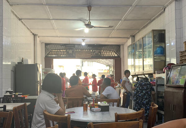 Image shows a humble coffee shop selling duck noodle soup in Medan