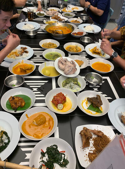 Image shows an Indonesian feast featuring an array of traditional dishes