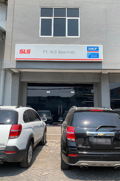Image shows the shopfront of SLS Jakarta office featuring the PT. SLS Bearindo signboard