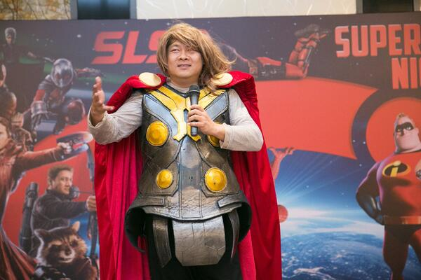 Image shows SLS Group CEO Mr. Roy Tan dressed as Thor, delivering his opening speech