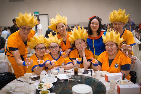 Image shows a group of people dressed as Dragonball characters posing for the camera