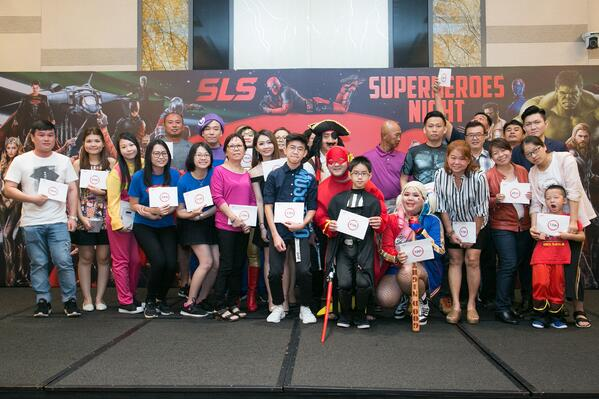 Image shows a group photo of prize winners on stage