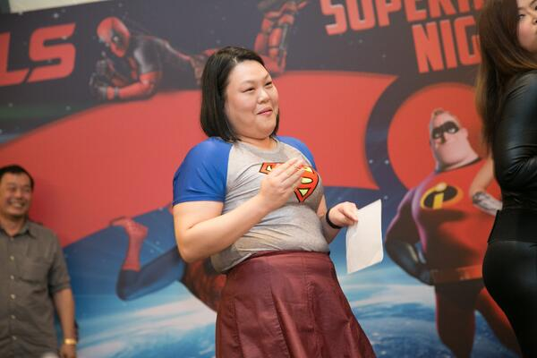 Image shows a woman dressed in a Superman tee