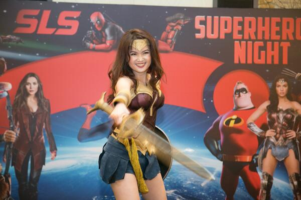 Image shows a woman dressed as Wonder Woman on stage