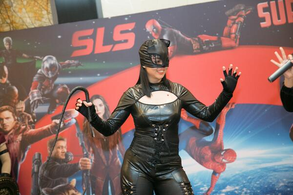 Image shows a woman dressed as Cat Woman