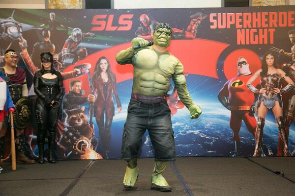 Image shows a man dressed as Hulk on stage