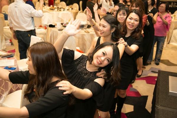 Image showing people doing the conga line dance