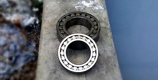 Image shows two bearings on a flat surface