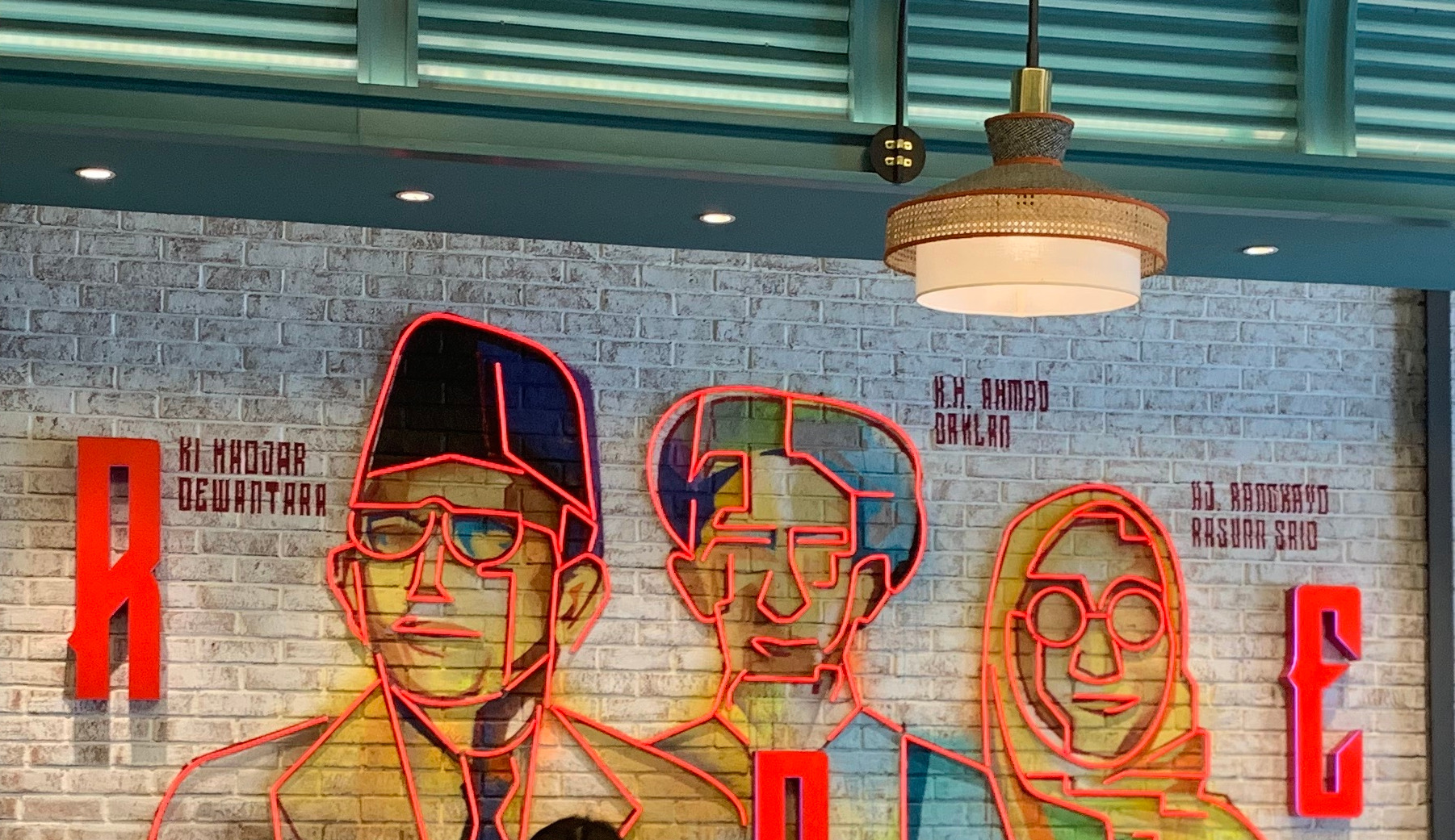 Image shows the mural wall of three monumental historical figures of Indonesia